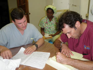 Team reviewing cases before surgery.
